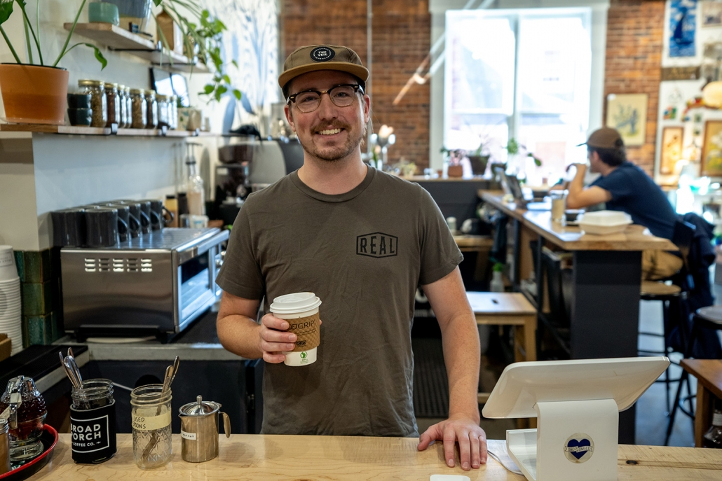 Broad Porch Coffee Company employee with coffee
